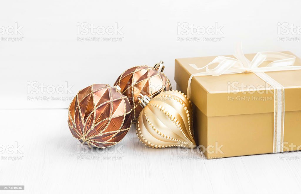 Golden Christmas tree ornaments with pearly balls decoration and stock photo