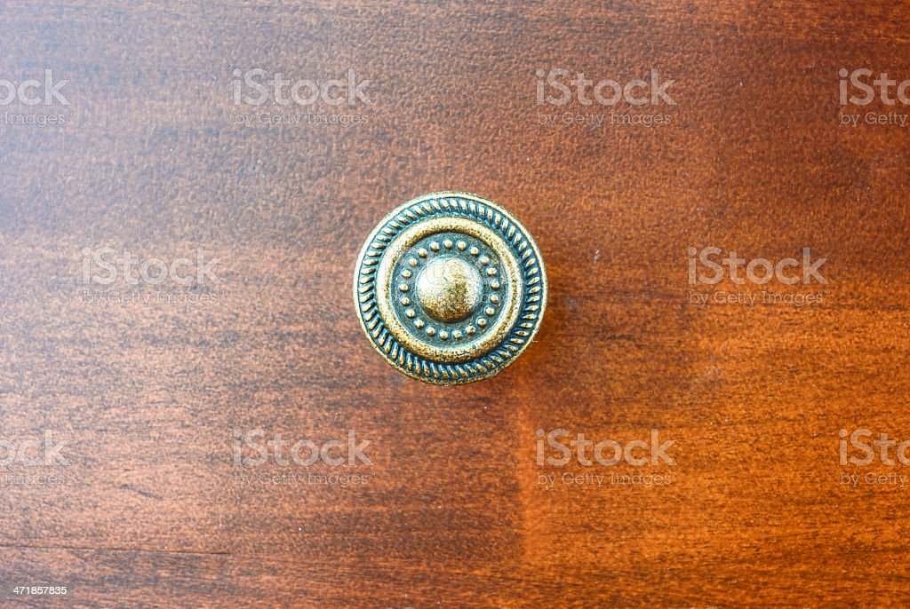 golden circle handle on drawer stock photo