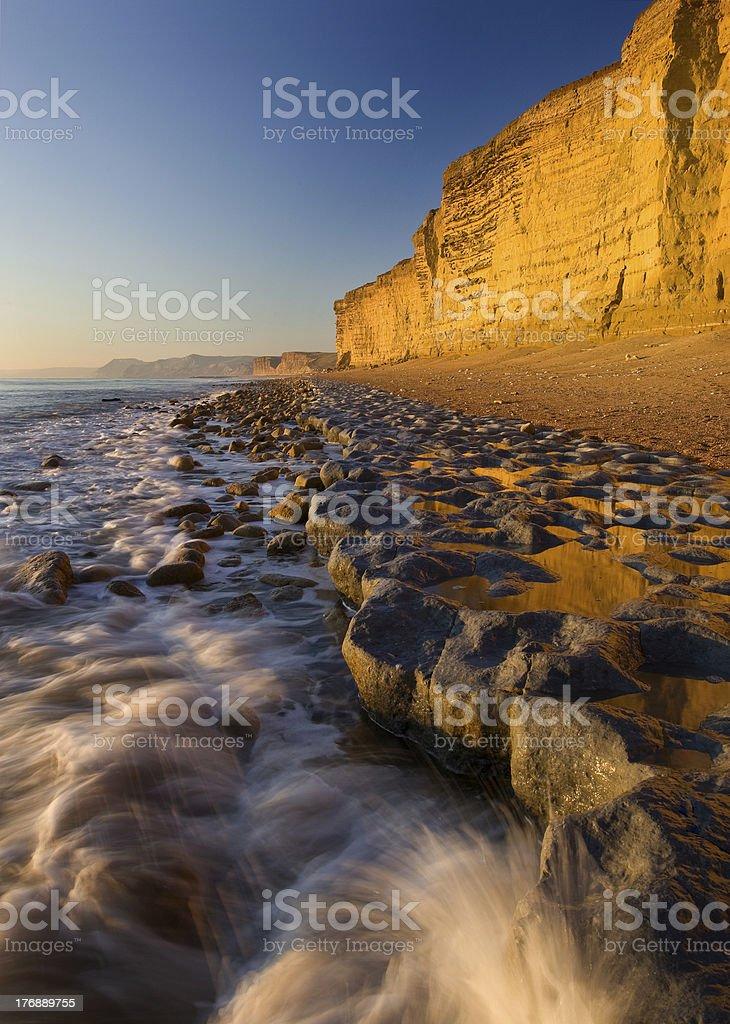 Golden cliffs & incoming tide , Burton Bradstock, Dorset, UK stock photo