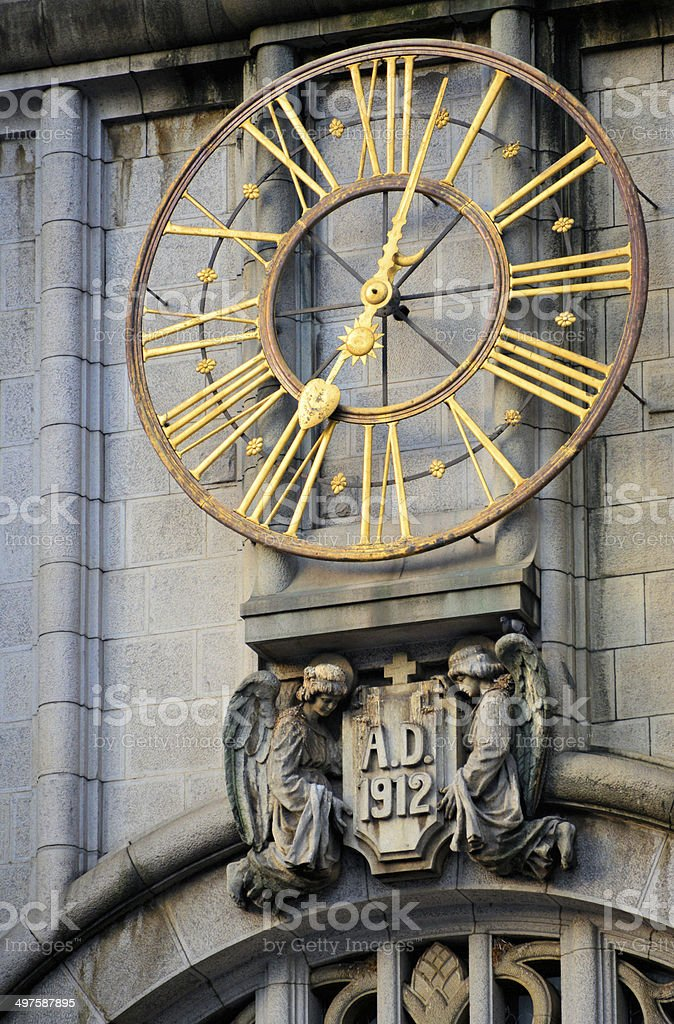 golden clock dial - angels hold the date 1912 royalty-free stock photo