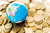 Golden coins and globe
