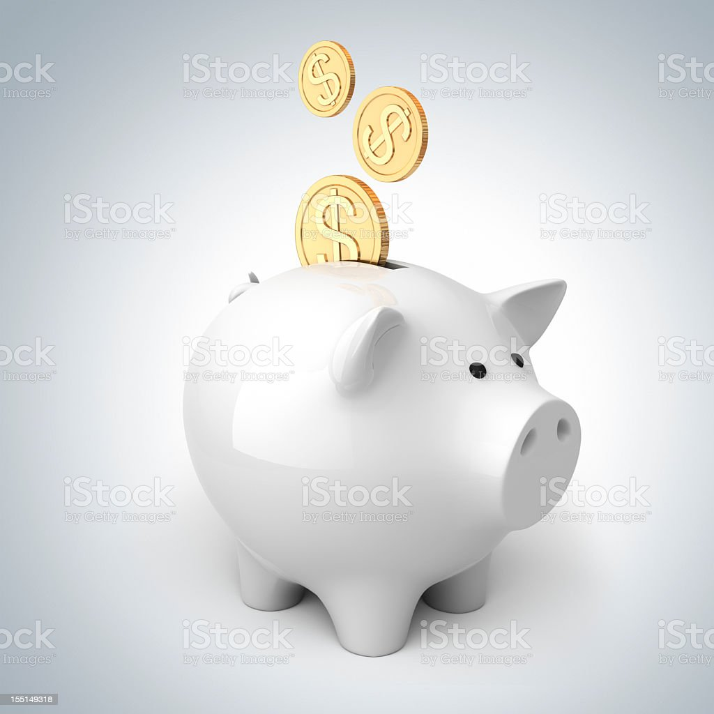 Golden coins being saved in white piggy bank for security royalty-free stock photo