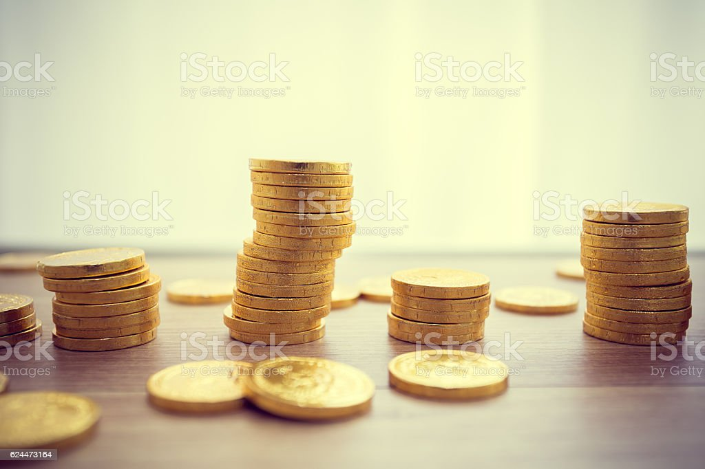 golden coins concept on a wood table. Taxpayer business concept stock photo