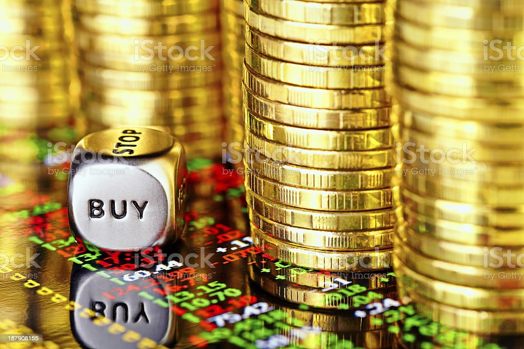 Golden coins, financial chart and dices cube royalty-free stock photo