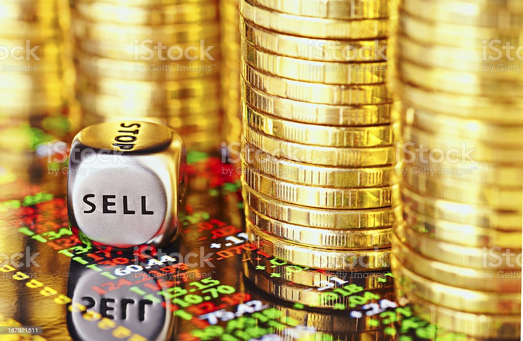 Golden coins, financial chart and dices cube stock photo