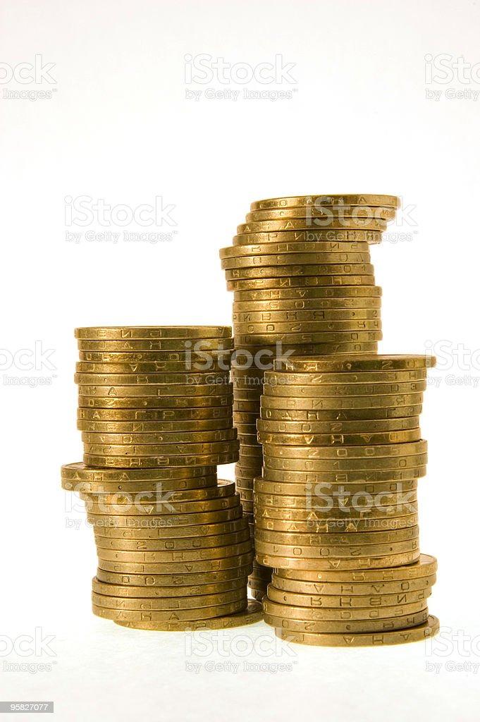 Golden coins in columns stock photo