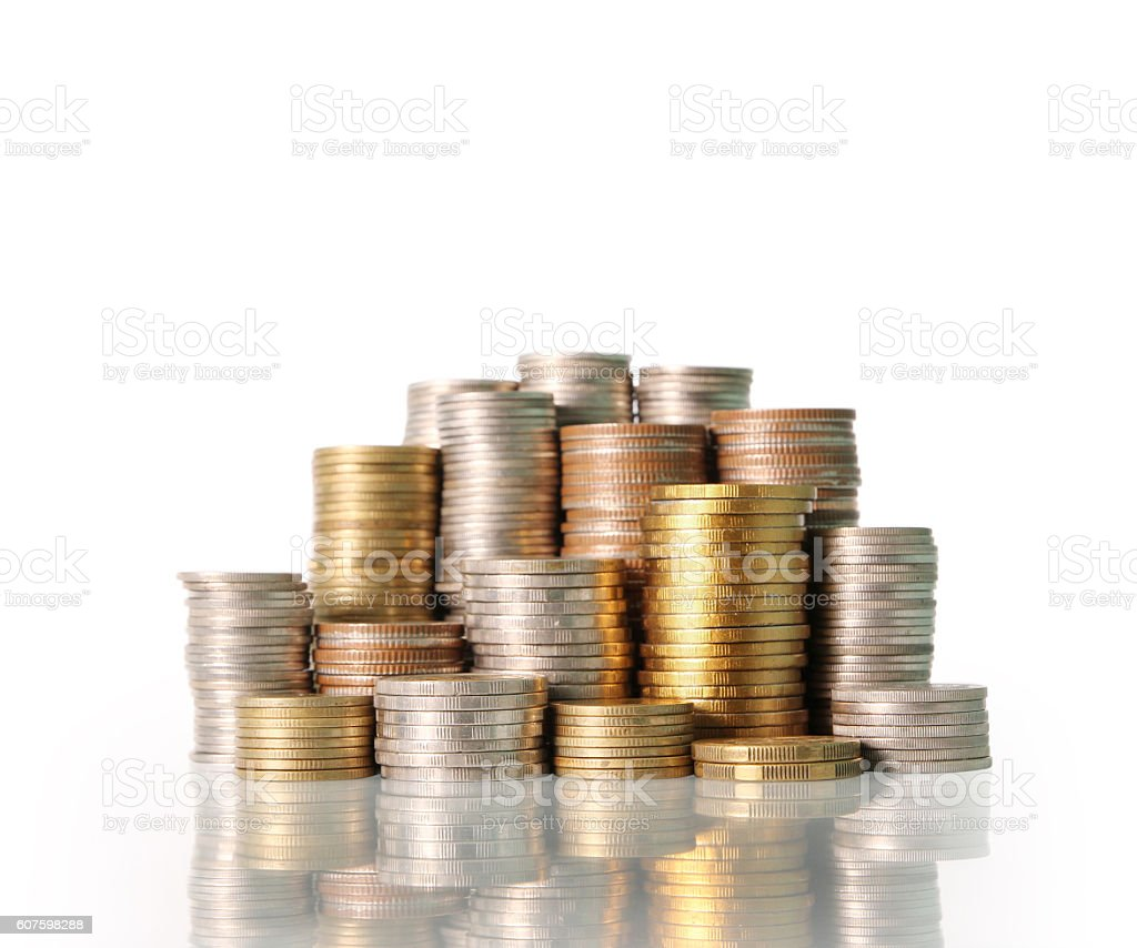 Golden coins isolated stock photo