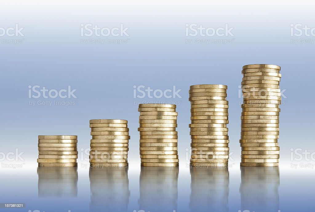 Golden coins of Euro in stacks royalty-free stock photo