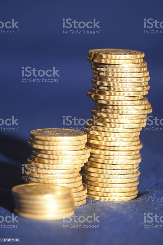 Golden coins on blue background stock photo