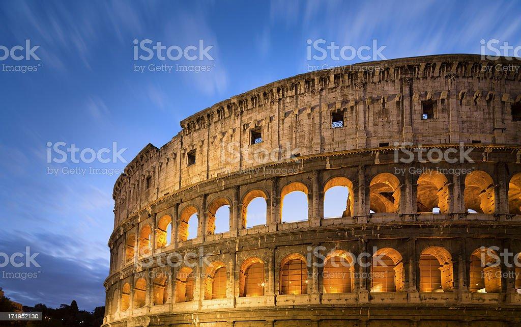 Golden Coliseum at dusk, Rome Italy royalty-free stock photo
