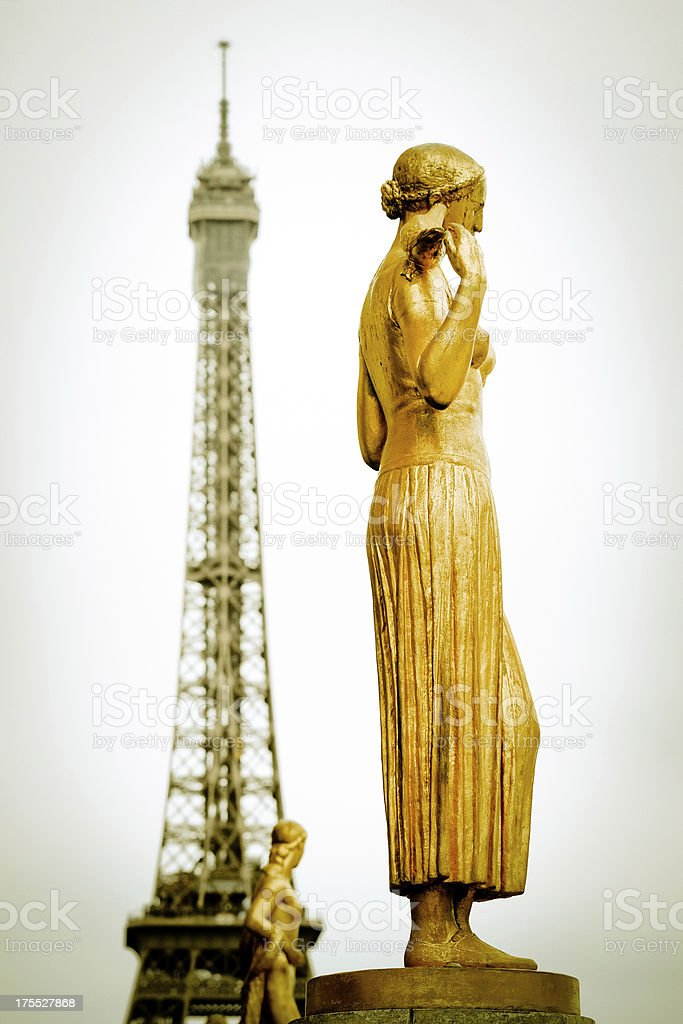 Golden Color Goddess Sculpture with Eiffel Tower Background - XLarge royalty-free stock photo