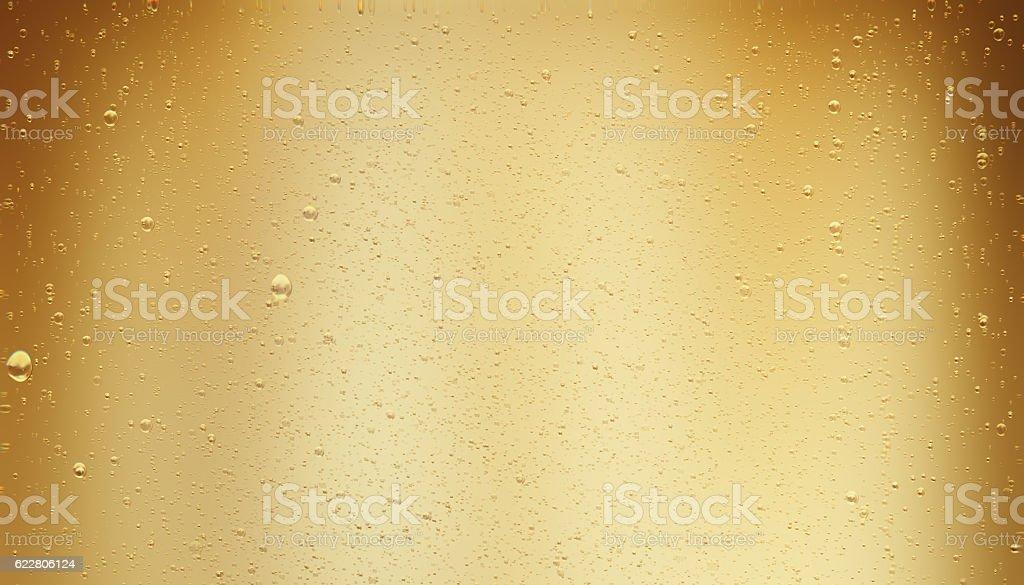 Golden Colored Sparkling Champagne Bubbles stock photo