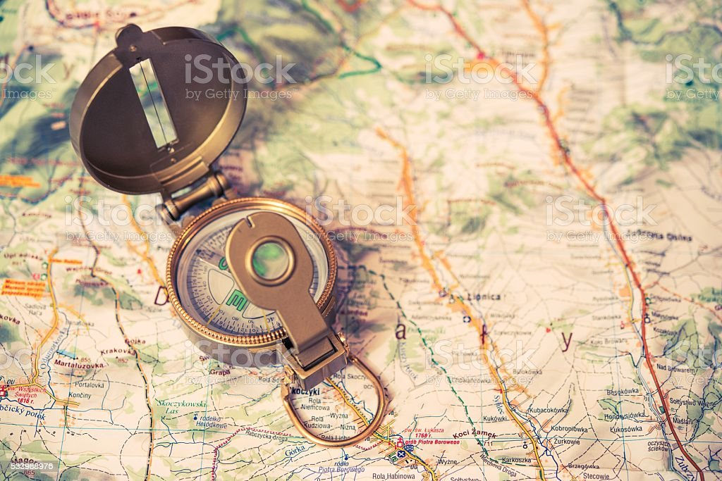 Golden Compass and Map stock photo