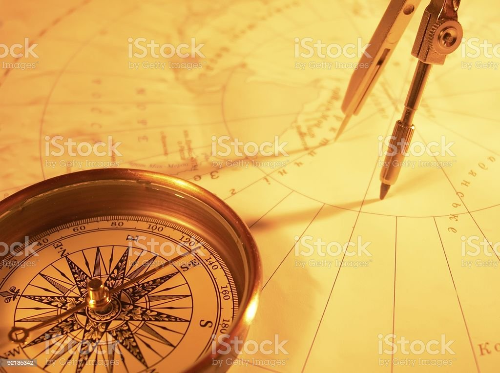Golden compass on a map with protractor  stock photo