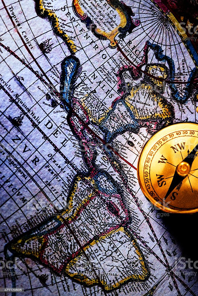 Golden Compass with Old Map royalty-free stock photo