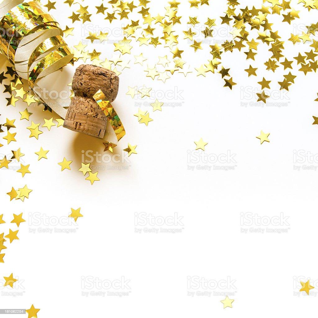 Golden confetti in stars shape, streamers, Champagne cork, isolated stock photo