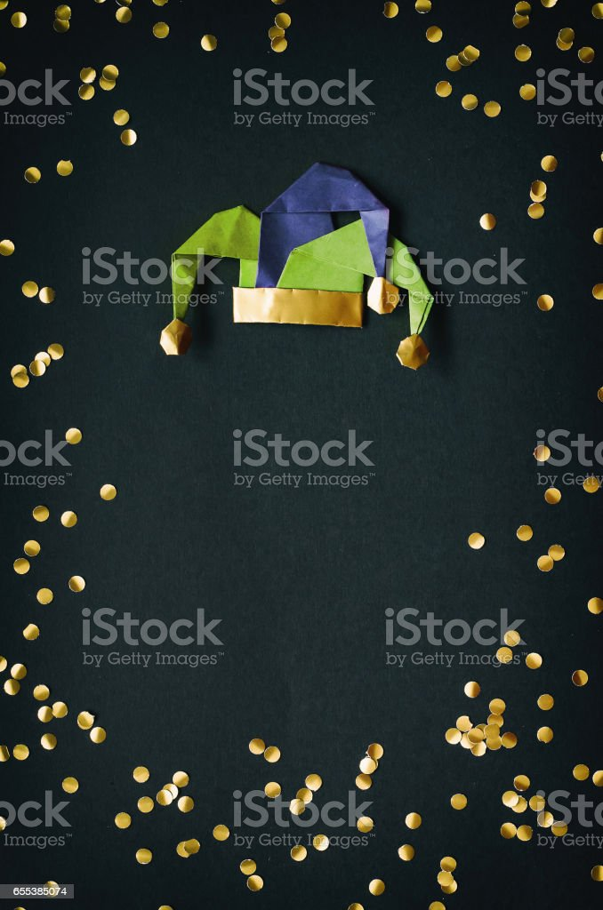 Golden confetti, jester masquerade hat. April Fools Day holiday decoration postcard, greeting, invitation card, banner template. Empty space, copyspace. stock photo