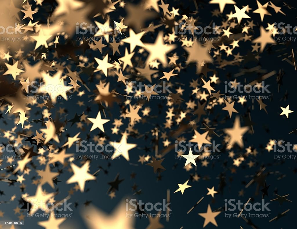 golden confetti stars falling stock photo