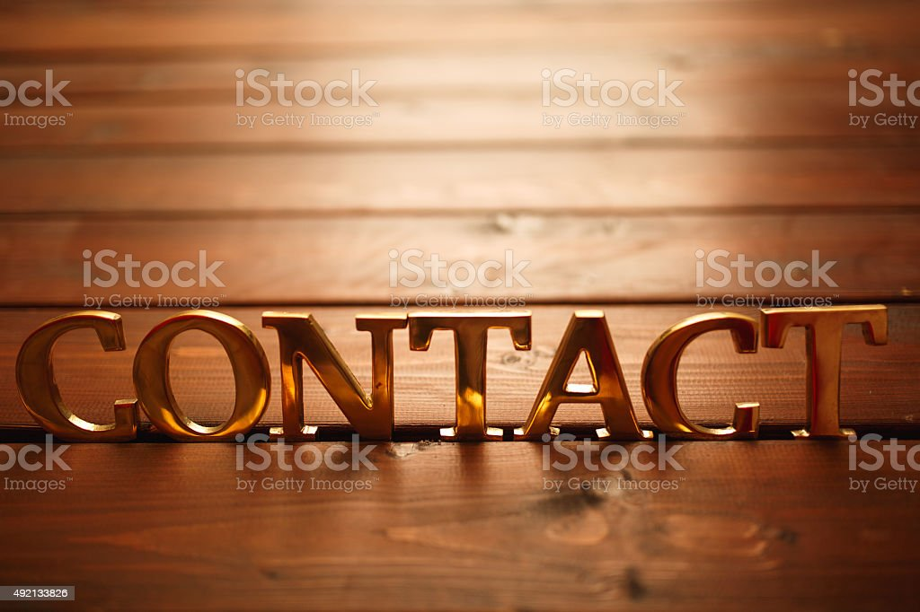Golden contact single word on wooden background stock photo
