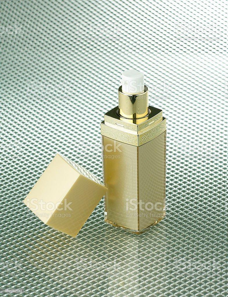 golden cosmetic bottle stock photo