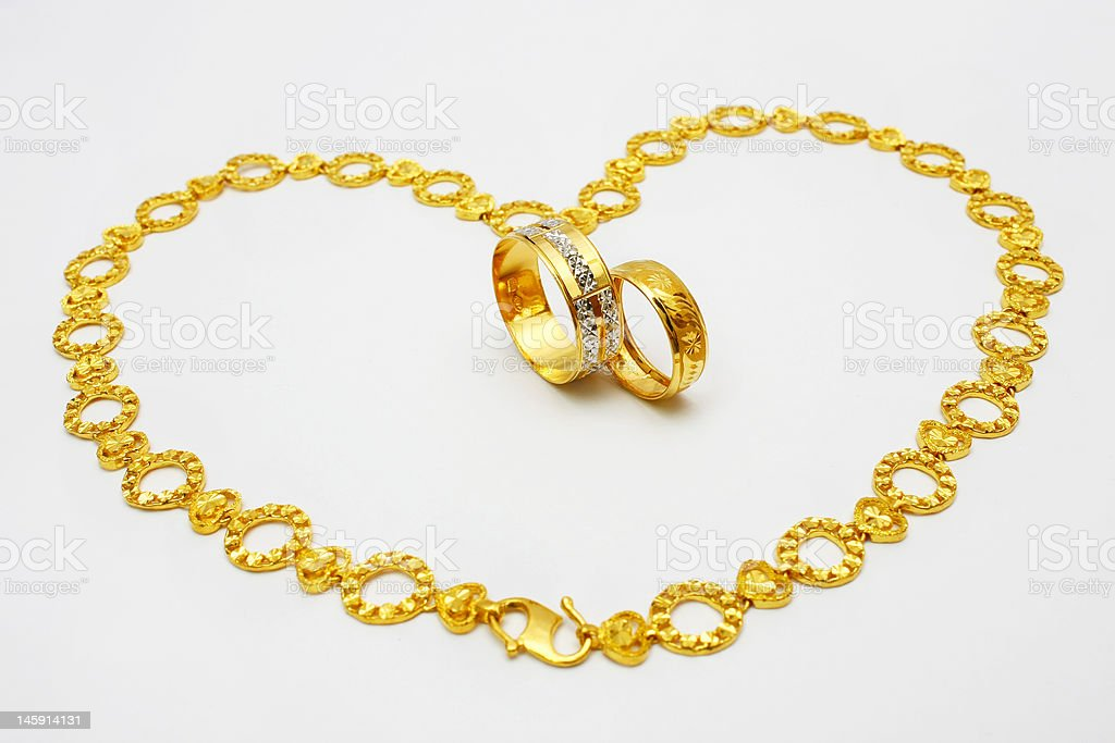 Golden Couple Ring and Necklace royalty-free stock photo