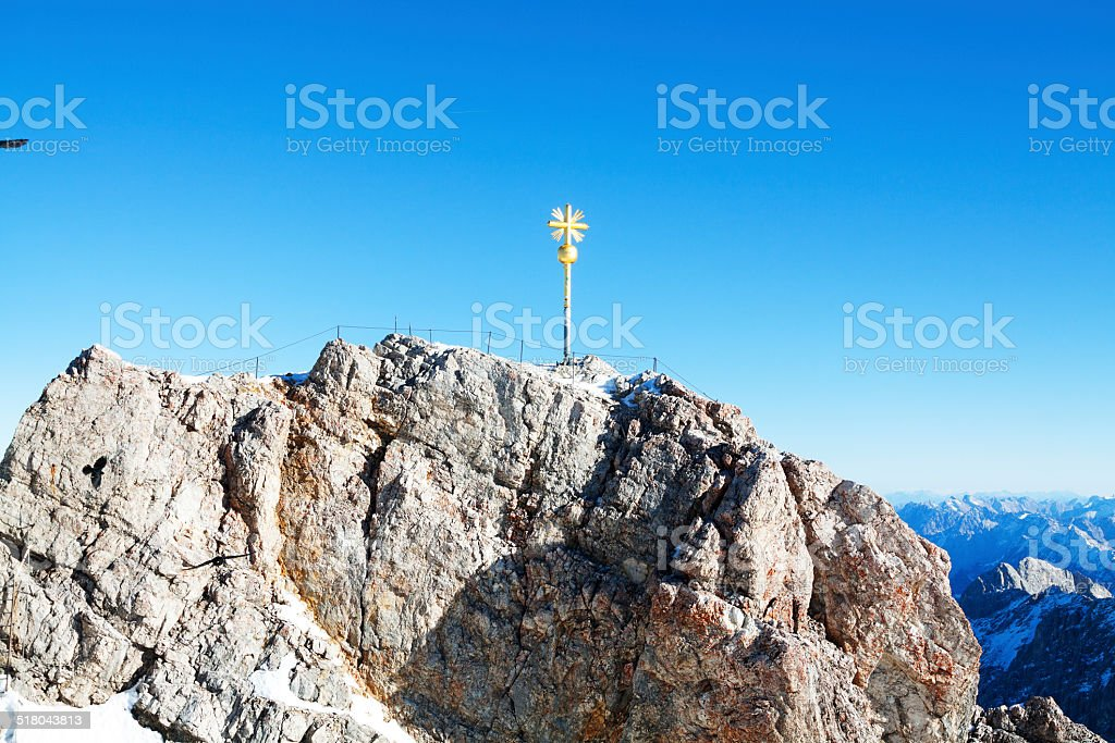Golden cross of Zugsitze stock photo