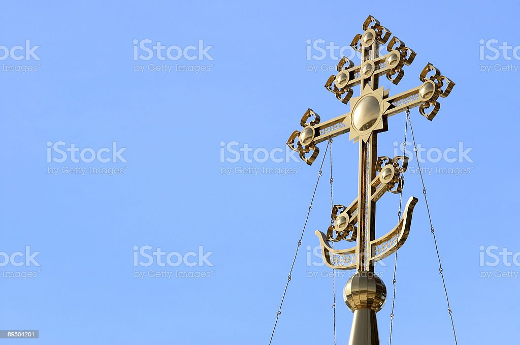 Golden cross stock photo