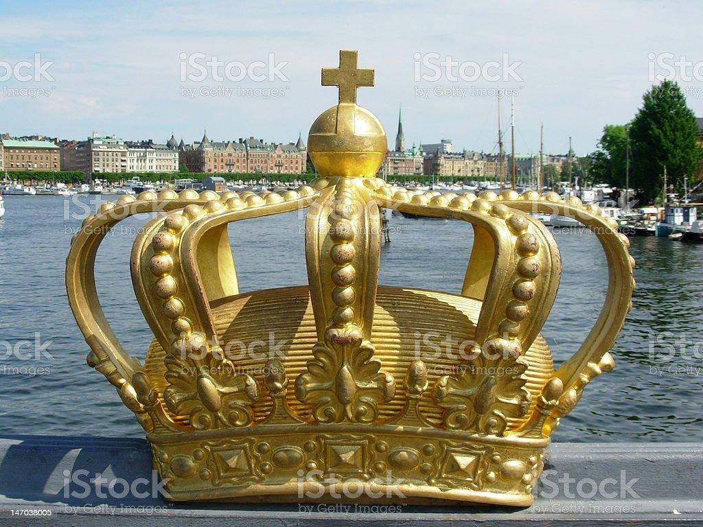 golden crown on Stockholm bridge stock photo