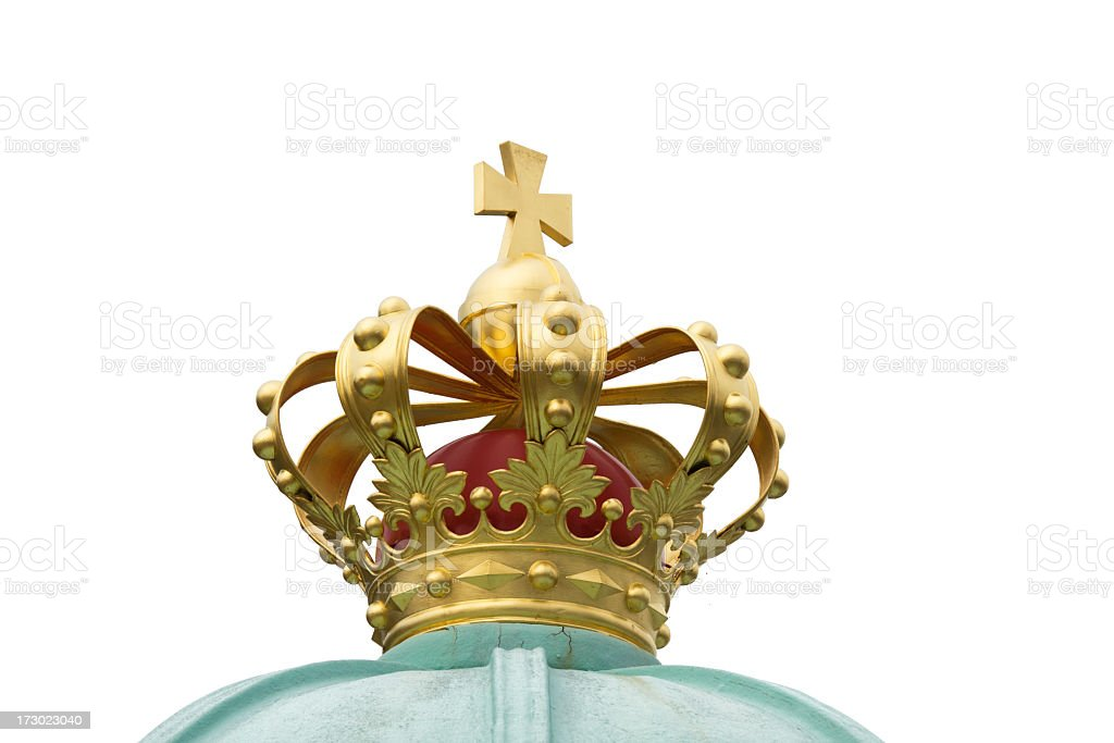 Golden crown on top of copper roof. Isolated. royalty-free stock photo