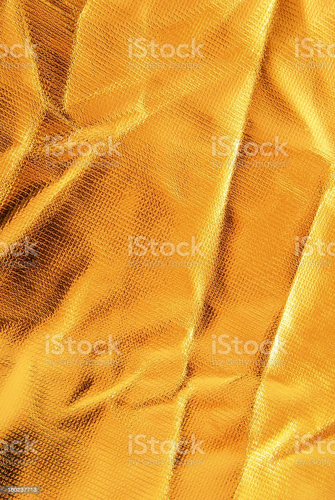 golden crumpled  fabric texture royalty-free stock photo