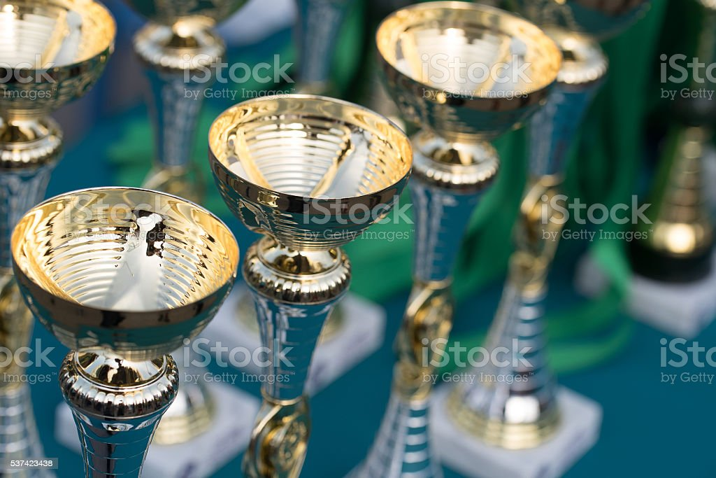 Golden cups as a trophy of sports competitions stock photo