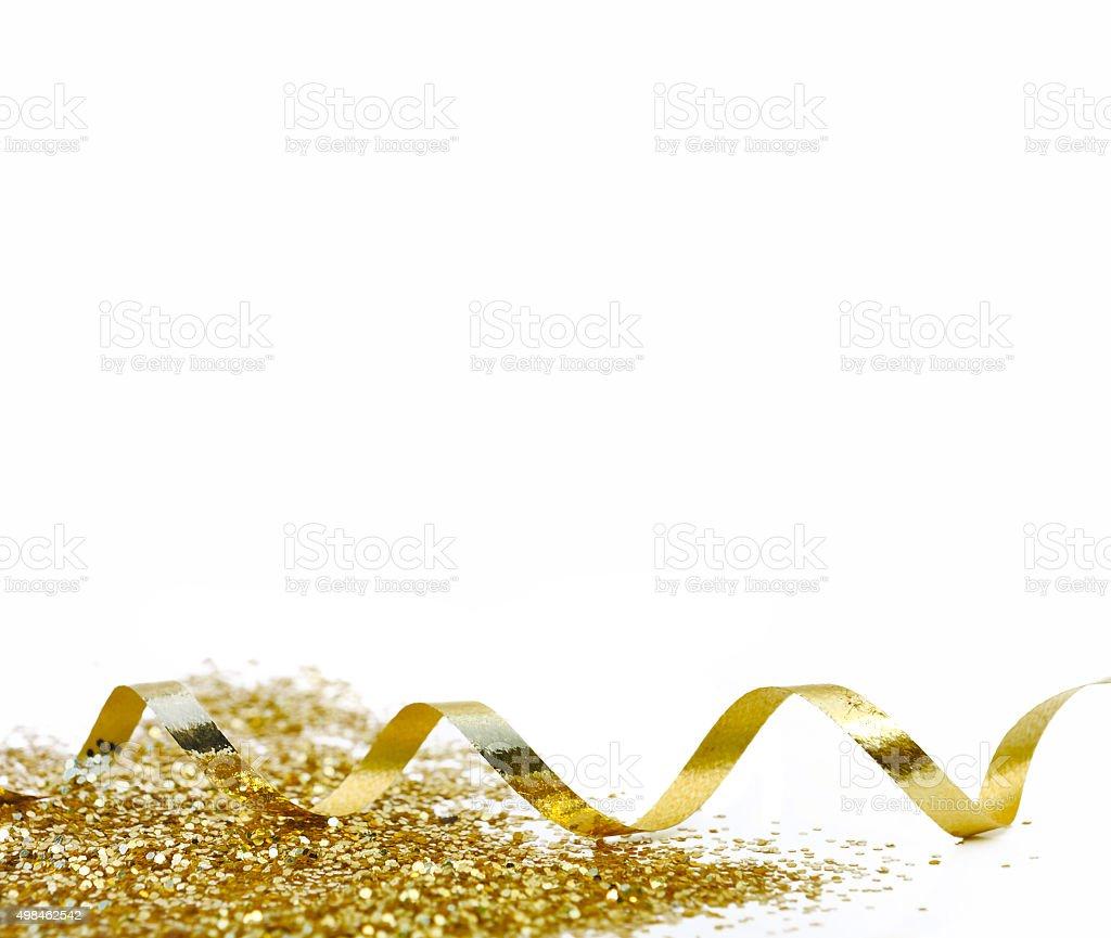 golden curling ribbon stock photo