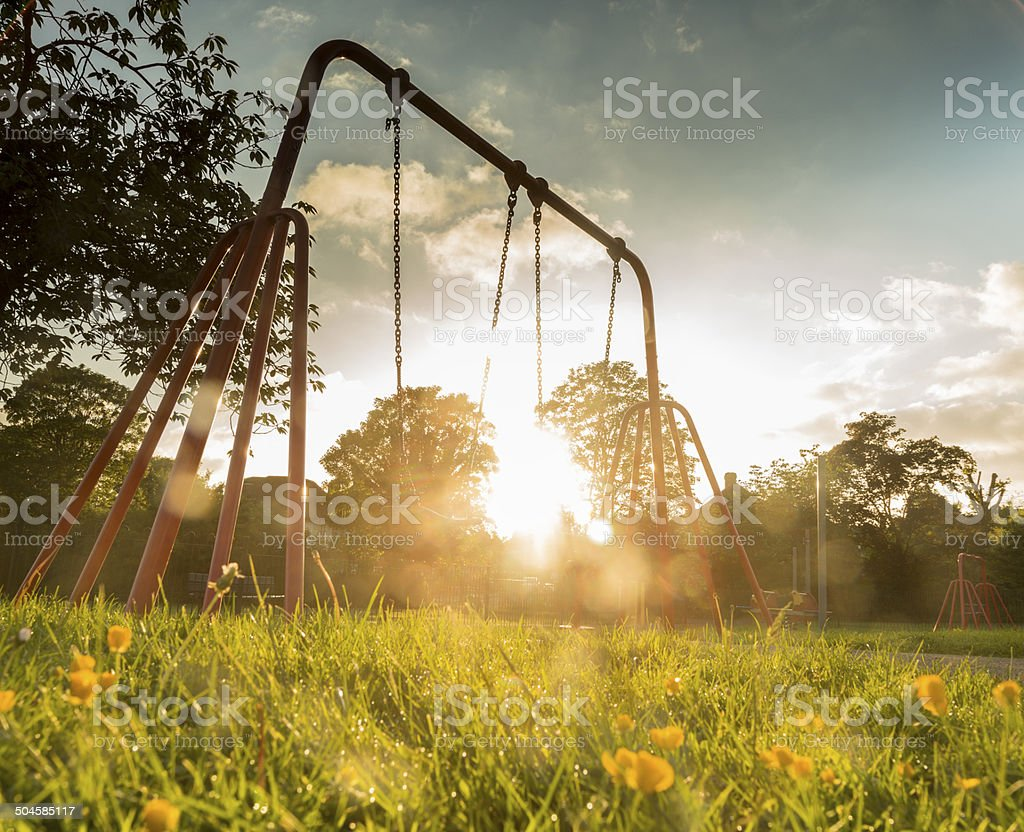 golden day by the park swing stock photo