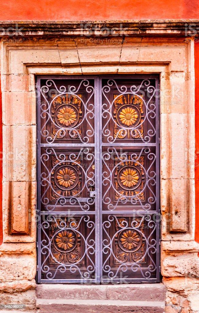 Golden Decorated Metal Brown Wooden Door San Miguel Mexico stock photo
