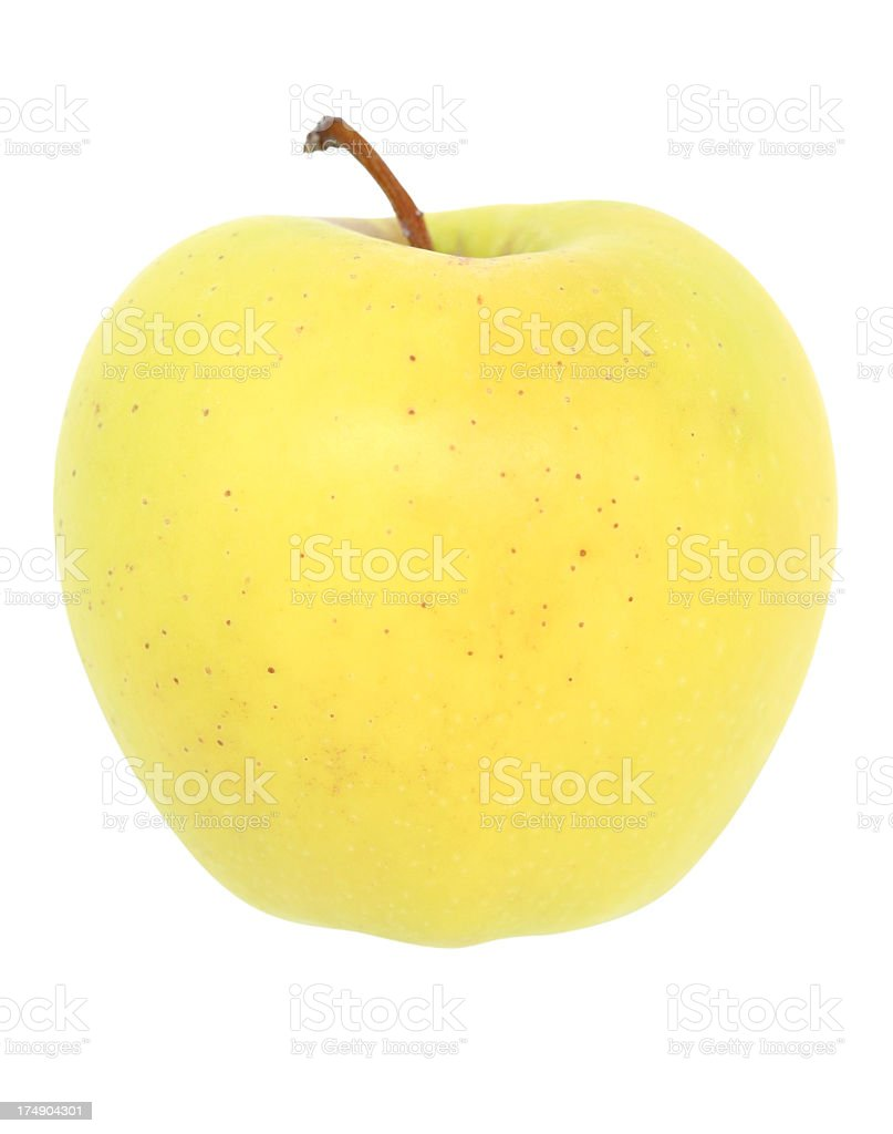 Golden Delicious apple against a white background stock photo
