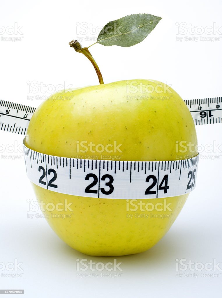 golden delicious apple tape measure royalty-free stock photo