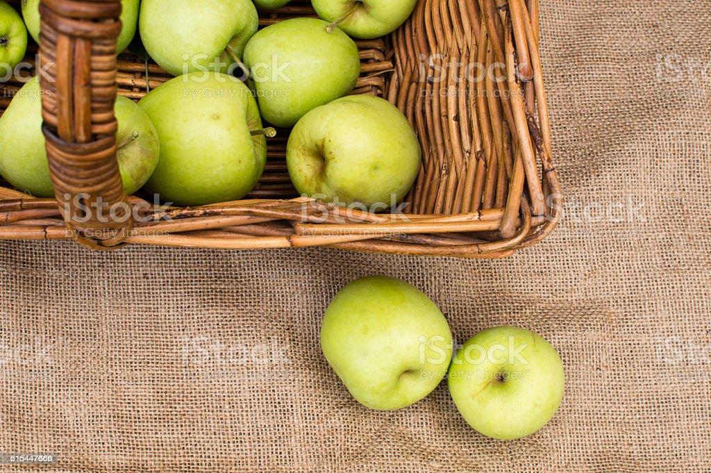 Golden delicious apples in basket stock photo