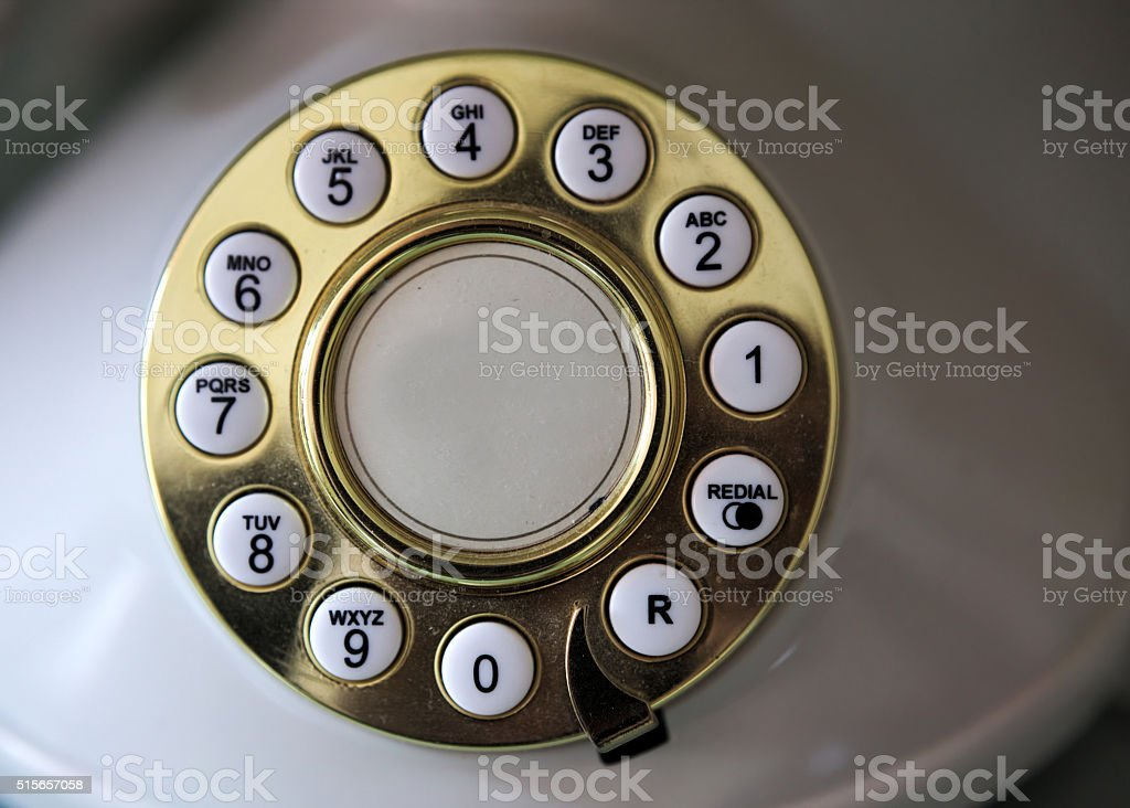 Golden dial plate of a vintage phone stock photo