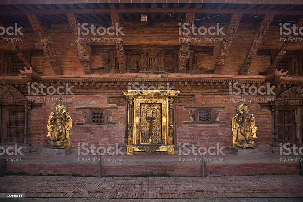 Golden door and sculptures of  old palace in Patan, Nepal stock photo