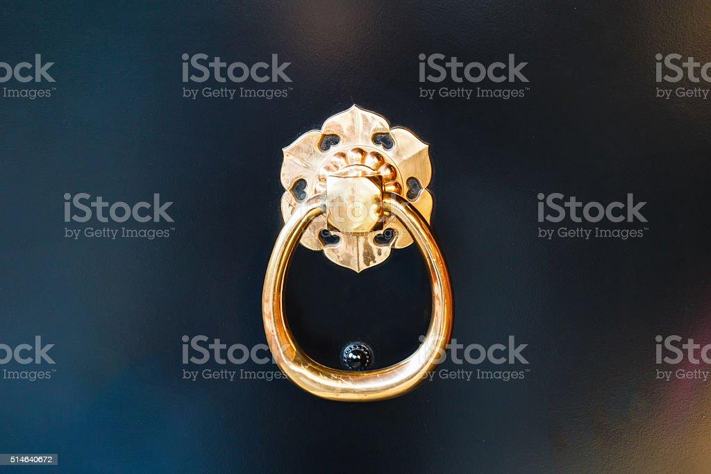 Golden door knocker. stock photo