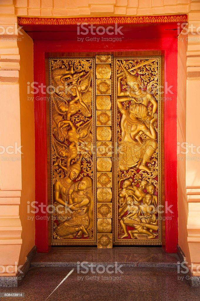 Golden door of Wat Inpeng stock photo
