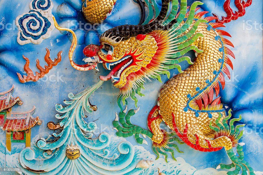 Golden dragon on Chinese temple wall stock photo