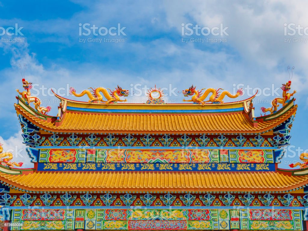Golden Dragon sculpture on the roof with beautiful color and blue sky background stock photo