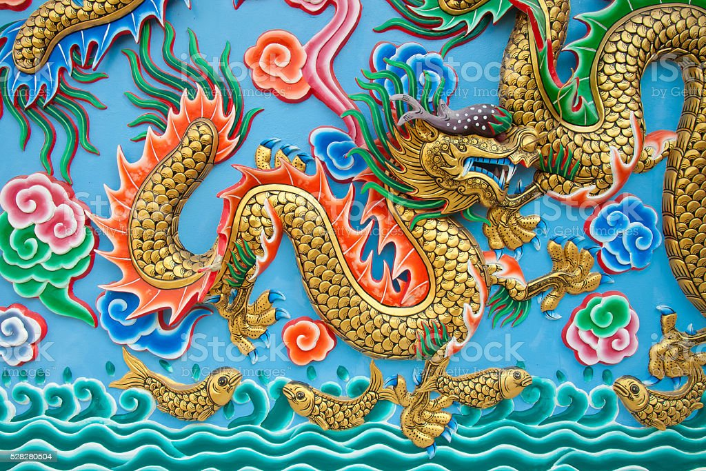 Golden dragon statue on blue wall royalty-free stock photo