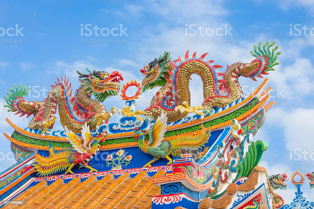Golden dragon statue on public shrine roof stock photo