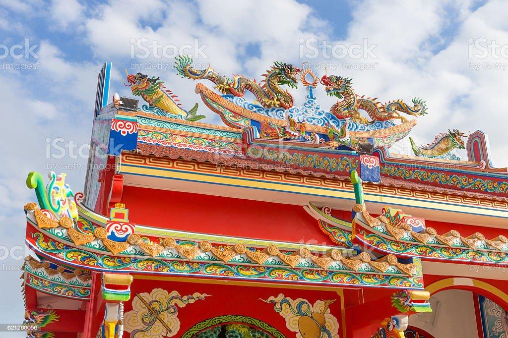 Golden dragon statue on public shrine roof stock photo