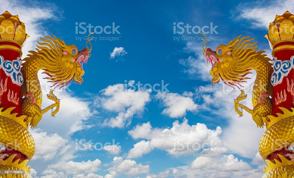 Golden Dragon Statues With Blue Sky royalty-free stock photo