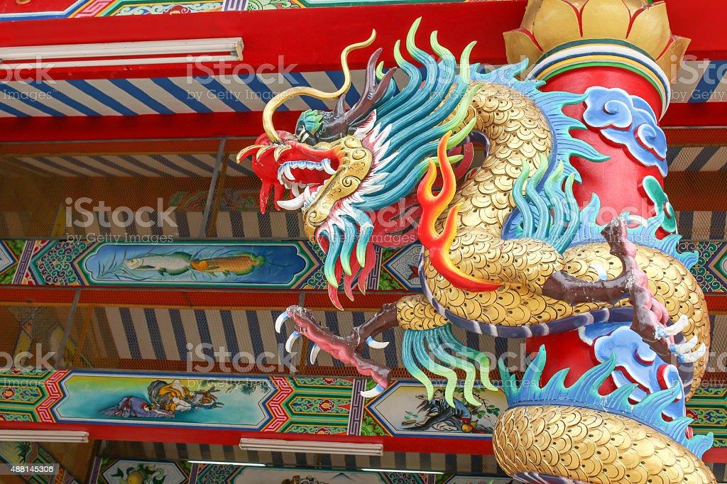 Golden dragon wrapped around the pole stock photo