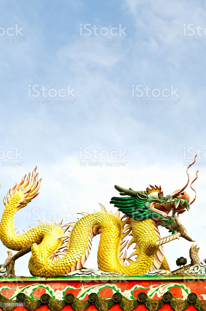 Golden dragons on the chinese temple with blue sky stock photo