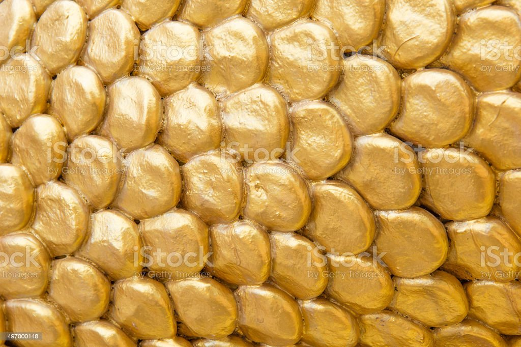 Golden dragon's scale stucco. stock photo